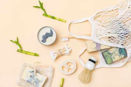 Flat lay of different hygiene and care items arranged camel color. Zero waste concept 写真素材