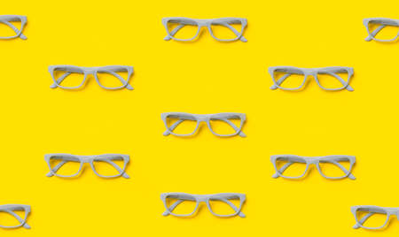 Grey glasses on a yellow background. Top view, space for your text
