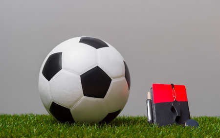 Football soccer referee equipment on green grass background