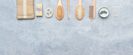 Zero waste bathroom accessories on grey background. Natural eco bamboo product. Plastic free beauty essentials. 写真素材