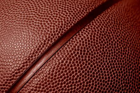 Closeup detail of basketball ball texture background. Red color filter. Banner art concept. Team sport 写真素材