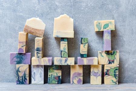 Handmade soaps on a grey background. Zero waste, eco friendly cosmetics concept. Eco lifestyle theme.