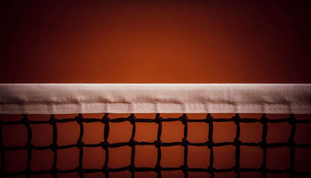 Tennis net with bokeh sand in the background. 写真素材
