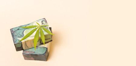 Homemade hemp soap and green leaf of marijuana. Spa organic soap. Organic skincare product with medicinal CBD. Zero waste concept 写真素材