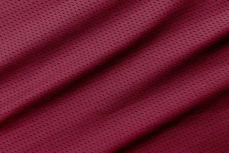 Red football, basketball, volleyball, hockey, rugby, lacrosse and handball jersey clothing fabric texture sports wear background 写真素材