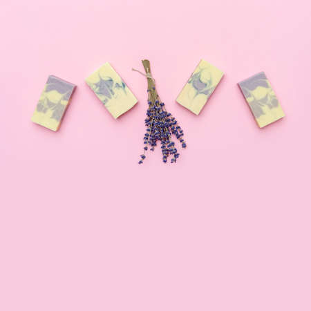 Natural handmade soap with dried lavender and essential oil on pink background. Zero waste concept 写真素材