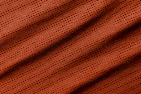 Orange football, basketball, volleyball, hockey, rugby, lacrosse and handball jersey clothing fabric texture sports wear background