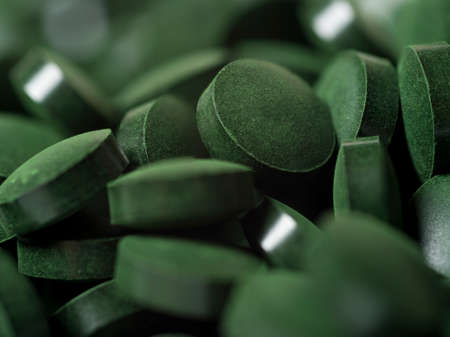 Chlorella or spirulina tablets close up. Nutrition and dietary dupplements. Vegan Protein 写真素材