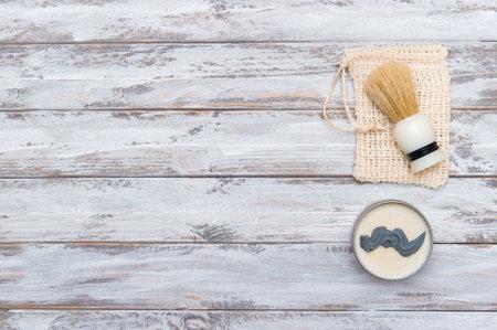 Shaving brush and shaving foam on wooden background. Spa organic foam. Zero waste concept 写真素材