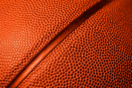 Closeup detail of basketball ball texture background. Orange color filter. Banner art concept. Team sport