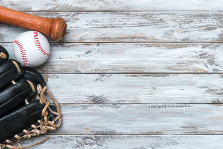 Baseball bat, glove and ball on wooden background.  Sport theme background with copy space for text and advertisment 写真素材