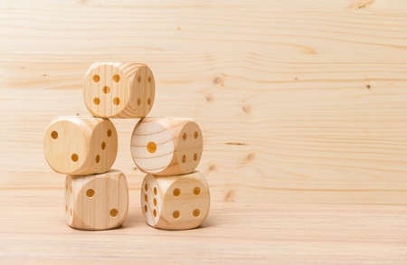 Gaming dice with copy space on wooden background. Concept for games, game board, presentation, banners or web. Top view. Close-up.