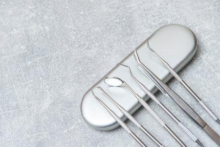 Dentist tools and mask on grey background. Dental banner or background
