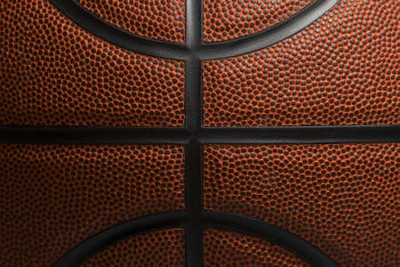 Closeup detail of basketball ball texture background. Team sport concept. Sports background for product display, banner, or mockup 免版税图像