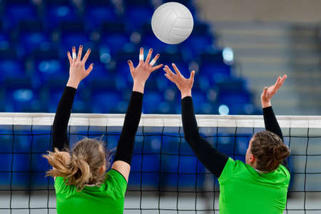 Volleyball game sport with group of girls indoor. Professional sport concept