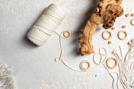Macrame accessories on cream color background. Creative hobby concept. Top view Archivio Fotografico