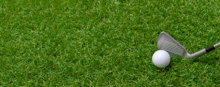 White golf ball and stick on green grass. Horizontal sport poster, greeting cards, headers, website