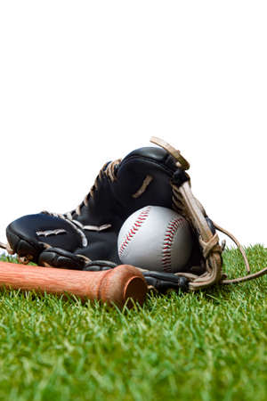 Baseball bat,shoes, glove and ball on green grass field. Sport theme background with copy space for text and advertisment Archivio Fotografico