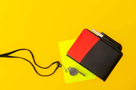 Football soccer referee equipment on yellow background. Top view, space for your text. Sport concept Archivio Fotografico
