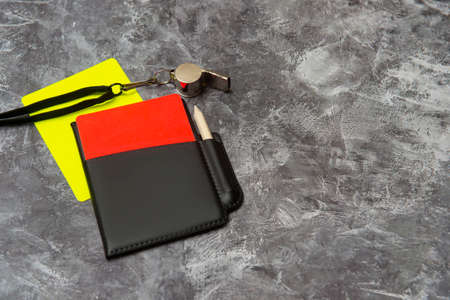 Football soccer referee equipment on grey background. Top view, space for your text. Sport concept