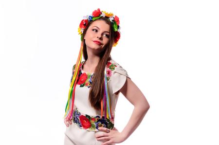 Girl in Ukrainian national traditional costume holding her flower chaplet