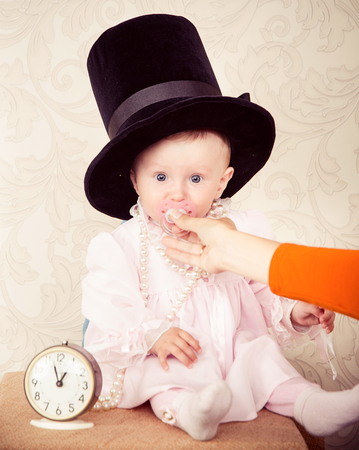 coif: The baby around the clock on a background of ivory