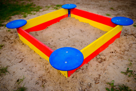 A nice sandbox playground filled . Surrounded by green grass, seen from top. Stock Photo