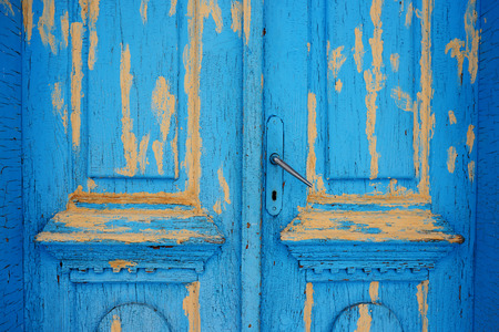 The doors made of wood painted blue.