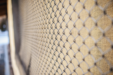 metal grate: fence with metal grid in perspective, background Stock Photo