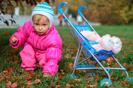little girl playing with sidecar, fall season