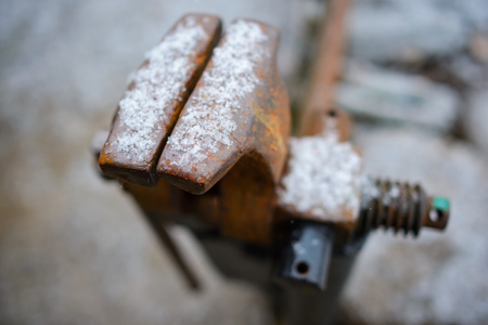 Old rusty table vises for handwork on metal and wood.