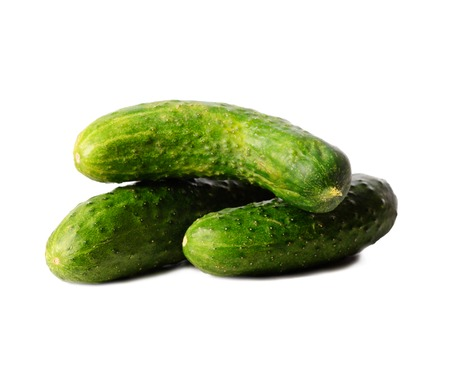Ripe, washed appetizing and tasty bright green cucumber on a white isolated background.