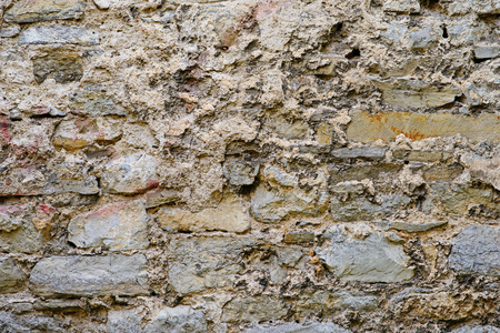 texture of old medieval castle wall made from gray stones. Banco de Imagens