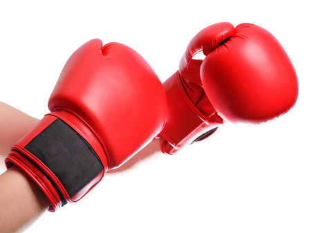 isolated hands in red boxing gloves on white background.