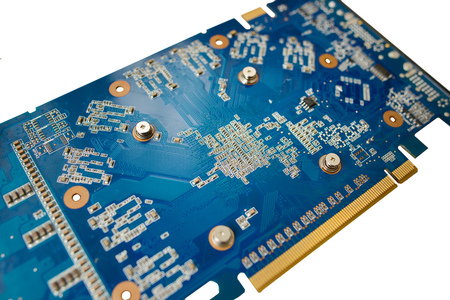 Blue isolated motherboard or computer board with chips and component on it on a white background.