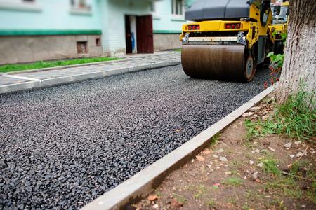 Background of asphalt roller that stack and press hot asphalt. Road repair machine.