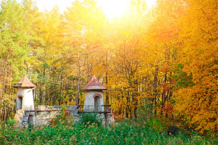 An old ruined and empty castle in the middle of the autumn forest. Stock Photo