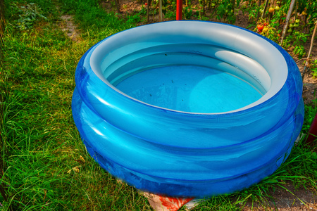 Plastic pool in a summer day outdoors.