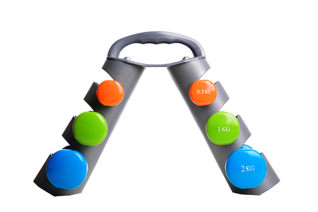 Set of colored isolated dumbbells for sport on a white background folded on a special gray stand.