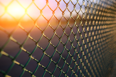 fence with metal grid in perspective, background Imagens