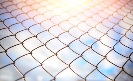 Blue sky behind a metal grate, background Stock Photo
