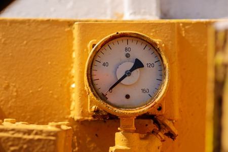 gauge pressure in the pipeline,a wall in the background.