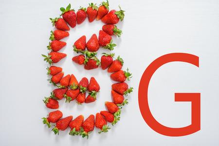 emblem 5g made up of fresh strawberries. Stock Photo