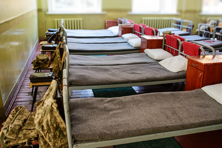 many beds in the military barracks of ukraine. 免版税图像