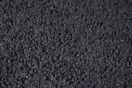 black tarmac texture useful as a background. Archivio Fotografico - 118032747