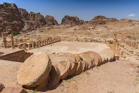Fallen columns at Great Temple Nabataean ancient town Petra, Jordan.