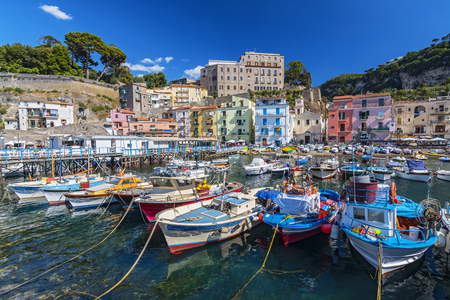 Small fishing boats at harbor Marina Grande in Sorrento, Campania, Amalfi Coast, Italy. 版權商用圖片 - 113571434