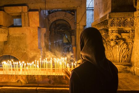 The pilgrim lit candles at the Church of the Holy Sepulchre in Jerusalem, Israel. Stock Photo
