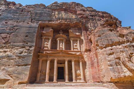 The Treasury of the Pharaoh building carved into the rock face at Petra in Jordan.