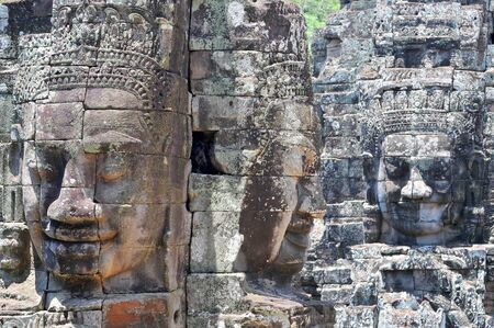Buddha faces in Bayon Buddhist Temple, Angkor Cambodia, Siem Reap. Stock Photo